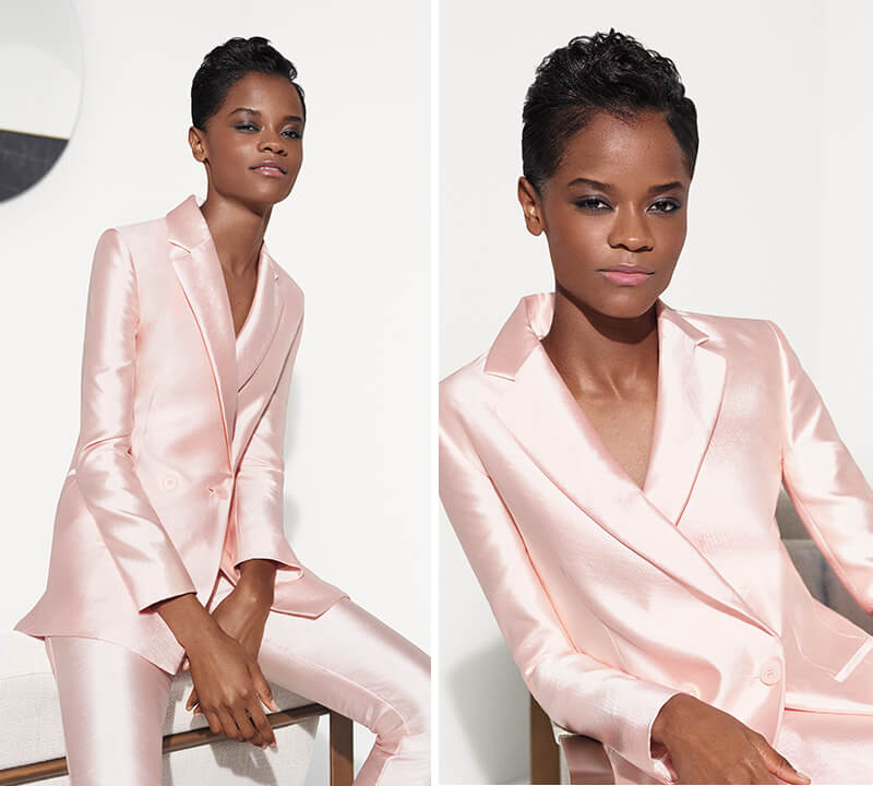 Letitia Wright in a pink suit