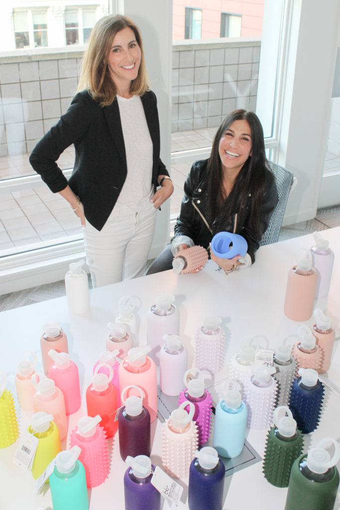 bkr founders surrounded by colorful glass and silicone water bottles