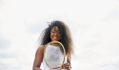 naomi osaka holding a tennis racket