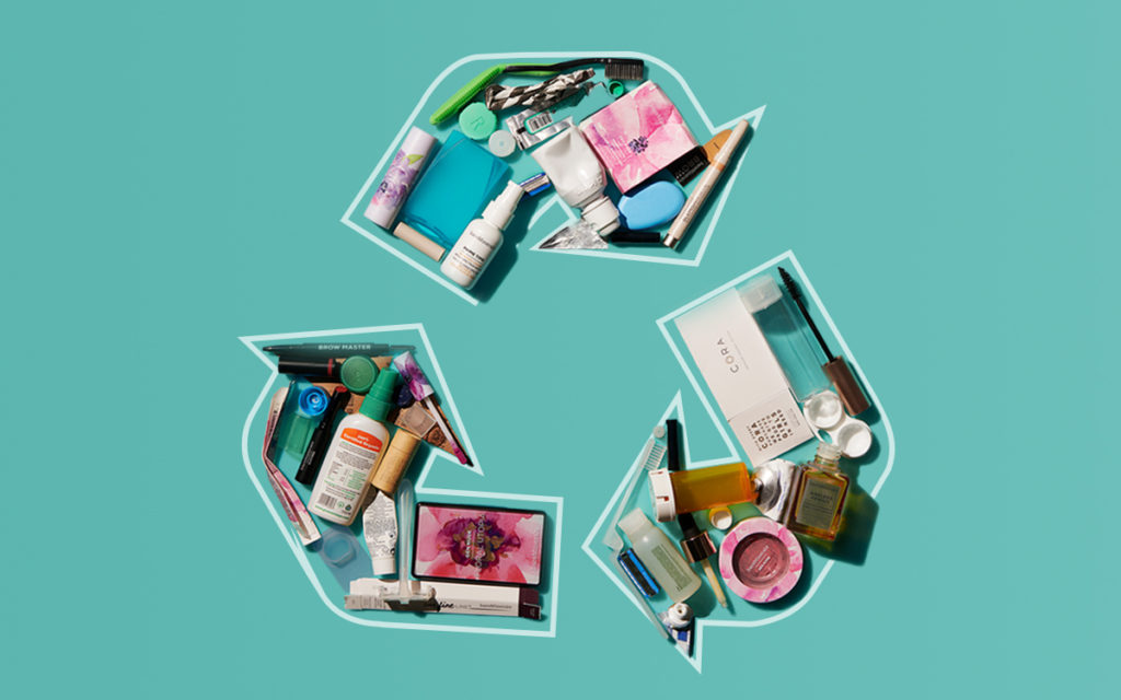 beauty products in the shape of a universal recycling symbol
