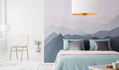 bedroom with bed and mural