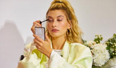 Hailey Bieber applying mascara